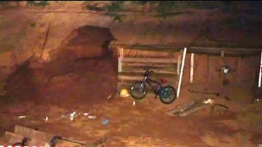 Two boys, aged 14 and 12, were playing in this storm drain when it collapsed on them.