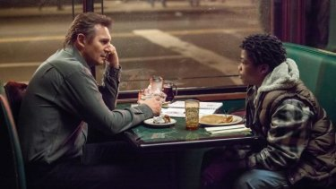 It's like this: Liam Neesan, left, in a scene with Brian Bradley who plays a homeless teenager.