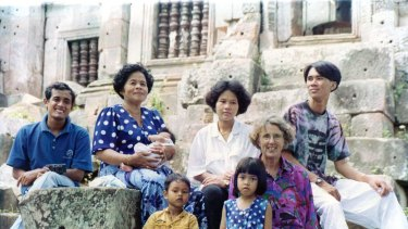 Joan Healy (front right) spends time with a Cambodian family during a visit to the ruins of a Khmer Monastery in Battambang Province in 1993.
