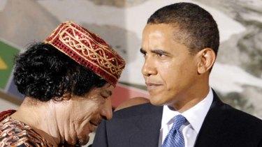 Barack Obama with Muammar Gaddafi.