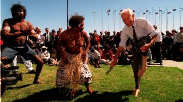 Former independent Tasmanian senator Brian Harradine removes his shoes and socks to dance with members of Cape York's Wik people outside Parliament House in Canberra in 1998.