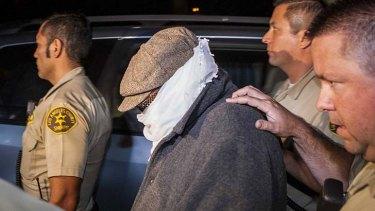 Nakoula Basseley Nakoula is escorted from his home in California.