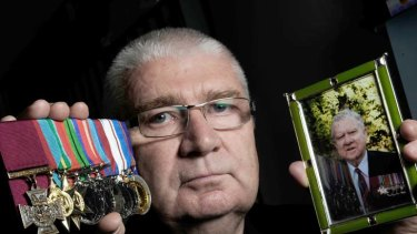 Son of an Australian who wouldn't give up … Rob Kenna with a photo of his father, Ted, and the medals earned in battle.