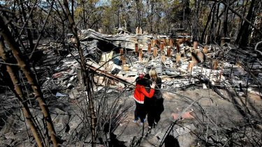 Standing before a home in Winmalee that was destroyed in the fires.