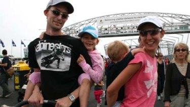 Ormiston family Dan Scott and Aline Barnett with children Georgia and Aidan foot-test the new Gateway Bridge.