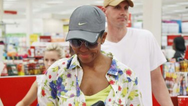 First lady ... Michelle Obama, wearing a hat and sunglasses, stands in line at a Target Department store in Virginia.