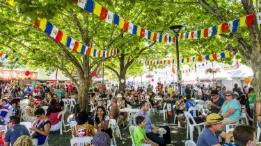 People rest in the shade at last year's Multicultural Festival.