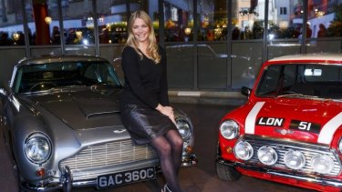 Petrolhead: Jodie Kidd host of <i>The Classic Car Show</i>, with an Aston Martin DB5 and Mini Cooper at the Soho Hotel in London in January.