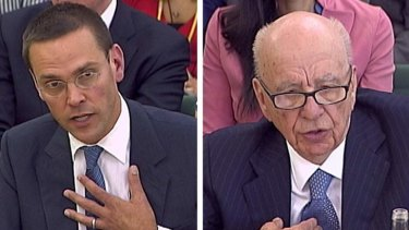 James (left) and Rupert Murdoch answer questions before a panel of  British parliamentarians.
