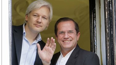 WikiLeaks founder Julian Assange waves from a window with Ecuador's Foreign Affairs Minister Ricardo Patino at Ecuador's embassy in central London.