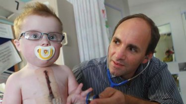 Tick of approval ... Tyler Lockyer, who recently had cardiac surgery, with Dr Phil Roberts at the Children's Hospital at Westmead.