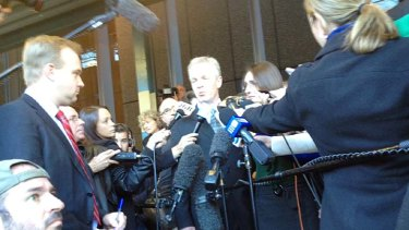 """Horrendous experience"" ... Jeffrey Gilham, with his wife Robecca by his side, addresses the media outside court."