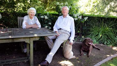 Tamie and Malcolm Fraser and their companions Grizzle and Choco in the garden at their Merricks property on the Mornington Peninsula.
