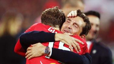 Joy: United head coach Guillermo Amor celebrates with Craig Goodwin.