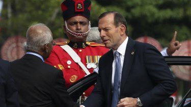 Prime Minister Tony Abbott arrives for the opening ceremony of the Commonwealth Heads of Government meeting in Colombo.