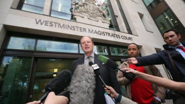 WikiLeaks supporter Vaughan Smith, centre, addresses the media outside Westminster Magistrates Court.