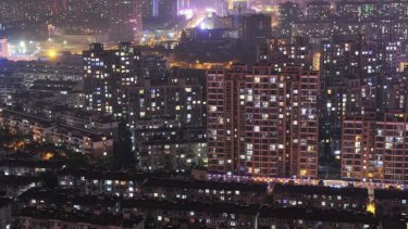 Chinese home prices fell for a fifth straight month in September: a night view of residential buildings in Hefei, Anhui province.