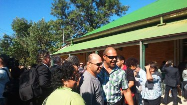 The Quandamooka people celebrate after the Federal Court's decision at a hall at Dunwich, North Stradbroke Island.