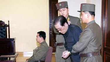 Jang Song-thaek escorted in court on December 12, 2013 before being executed.