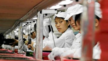 Workers are seen inside a Foxconn factory in Longhua, China in 2010. Foxconn, a major supplier of Apple is said to be improving workplace conditions.