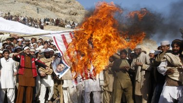 Afghan protesters burn a US flag during a protest in Jalalabad province in Afghanistan in February 2012 against the inadvertent burning of a Koran at a US military base.