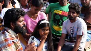 Tamil asylum seekers aboard the boat which was diverted by Indonesia to the port of Merak.