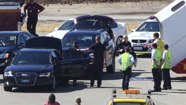 A band member of the Rolling Stones, reportedly Mick Jagger, walks from his car to the aircraft to board at Perth international airport on March 20, 2014 in Perth, Australia.