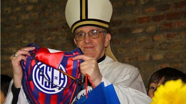 Argentine Cardinal Jorge Bergoglio poses with a jersey from the San Lorenzo soccer club.