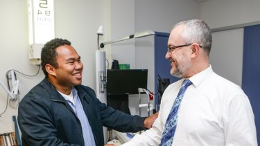Optimistic: Chris Lee is reunited with Michael Hennessy, who saved his right eye.
