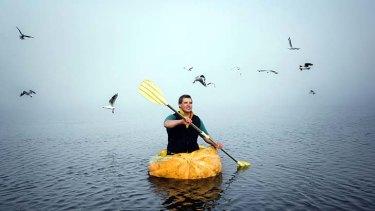 Captain and pumpkin: Racegoer Jonathan Taylor tests out his craft.