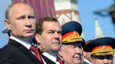 Russian President Vladimir Putin, left, and Prime Minister Dmitry Medvedev attend a Victory Day military parade in Red Square.