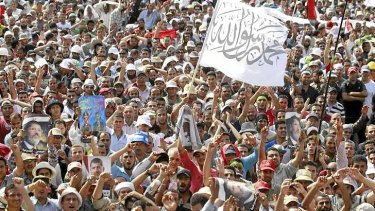 Members of the Muslim Brotherhood and supporters of deposed Egyptian President Mohamed Mursi shout slogans outside the at the Rabaa Adawiya square in Cairo.
