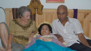 Theda with her mother Carol Adams and father Aung Myint.