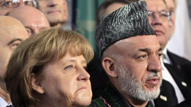 German Chancellor Angela Merkel and Afghan President Hamid Karzai during an international conference on the future of Afghanistan.