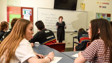 Williamstown High School VCAL students and teacher Anne Goller do the maths on gambling risks.