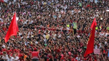 Foxconn employees gather to watch a rally at the Foxconn campus in the southern Chinese city of Shenzhen.