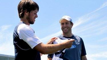 Aaron Baddeley receives a Geelong guernsey from Steve Johnson