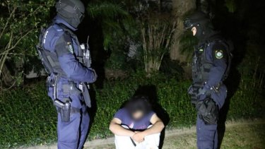 Fifteen people have been arrested and one charged in counter-terrorism raids in Sydney and Brisbane.