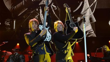 Richie Sambora and Jon Bon Jovi on stage together.