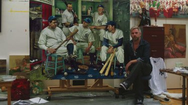 Former AFL footballer Jamie Cooper with his painting of the New York Yankees to be auctioned next month.
