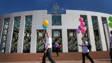 Happy he lost the bet ... Steve Keen leaves  Parliament House on his  225-kilometre walk to the top of Mount Kosciuszko.