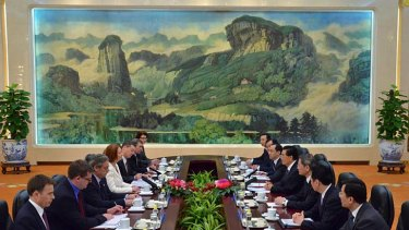 Julia Gillard, fourth from left, and Chinese President Hu Jintao, fourth from right, attend a meeting at the Great Hall of the People in Beijing.