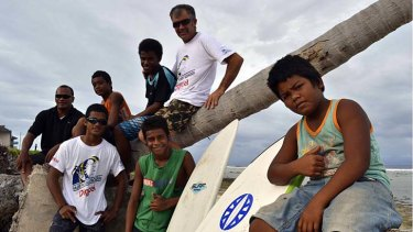 My island home ... John Short, who works as a rigger at the port, with members of the Nauru Surf Club he set up so Nauruans can teach asylum seekers the rudiments of ocean survival and swimming.