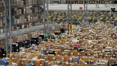 Parcels are processed and prepared for dispatch at an Amazon fulfilment centre in Peterborough, England.