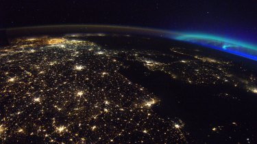 Berlin at the bottom and Belgium at the top, with the aurora borealis at right, in a picture by Pesquet.