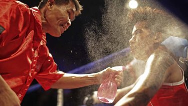 """""""Punching harder than most blokes I know"""" ... Usanakorn receives instructions in her corner."""