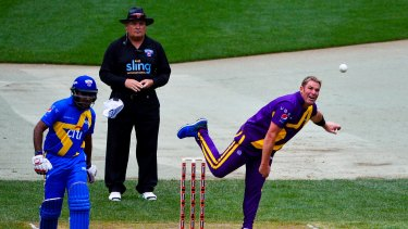 Shane Warne rolls the shoulder ove at at Citi Field in Queens.