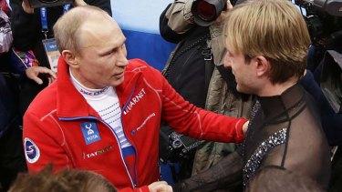 Golden moment: Vladimir Putin congratulates Evgeni Plushenko.