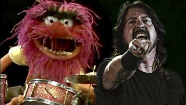 Dave Grohl has challenged Animal to a drum-off on The Muppets.