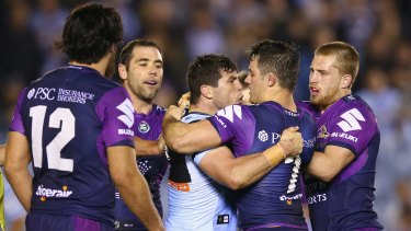 Getting under the opposition's skin: Michael Ennis and Cooper Cronk scuffle.